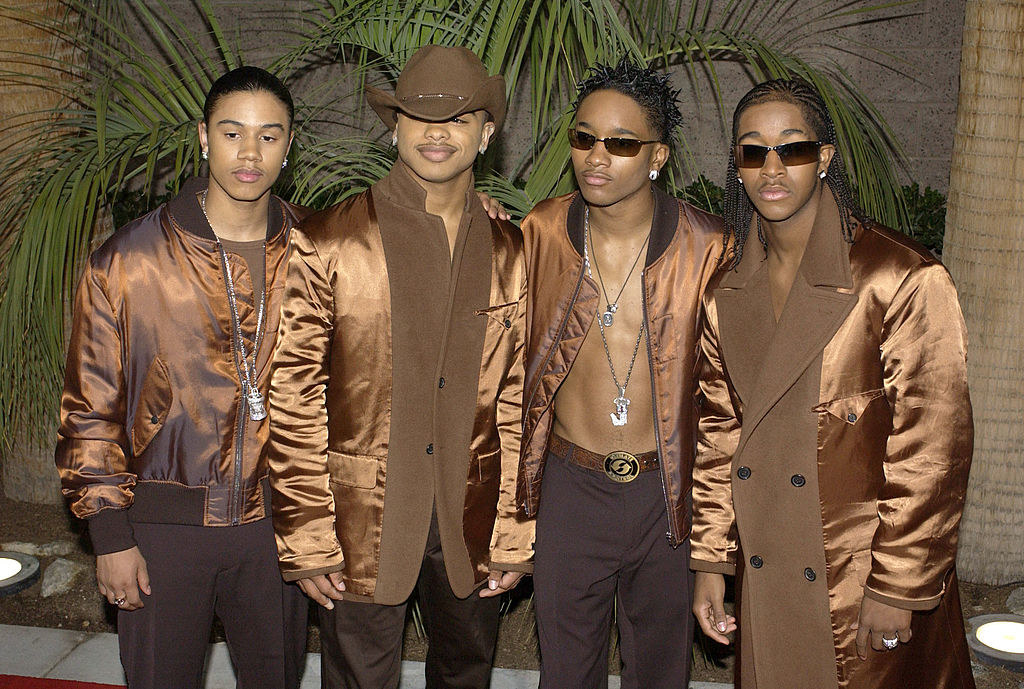 B2K in different brown outfits that all kind of match
