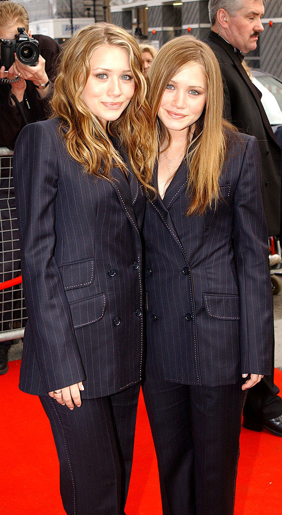 The Olsen twins wearing business suits