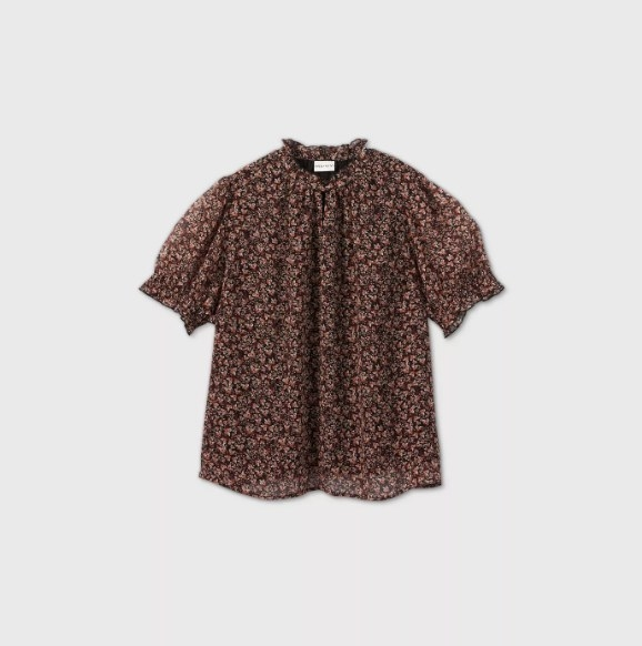 The maroon floral blouse