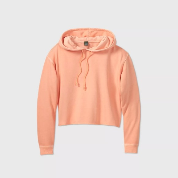 The salmon colored cropped hoodie with tie strings