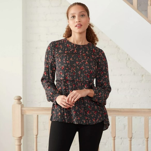 Model wearing the long-sleeved floral shirt
