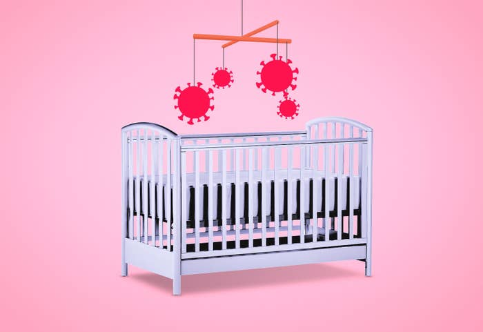A mobile with Coronavirus molecules hangs over a baby's crib.