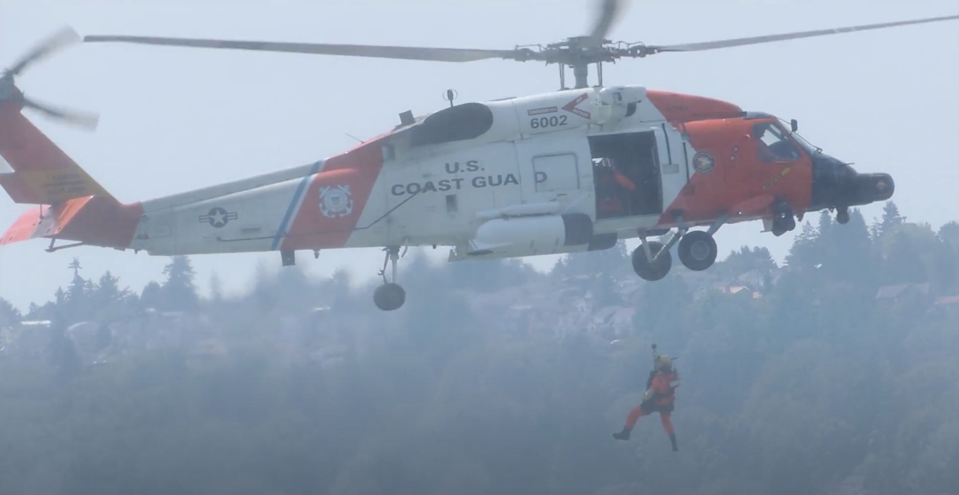 A helicopter airlifts someone