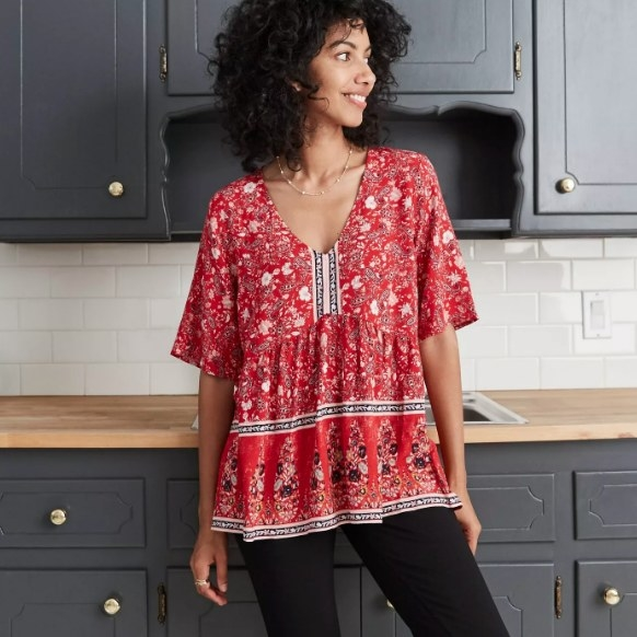 Model wearing the paisley print short sleeve blouse