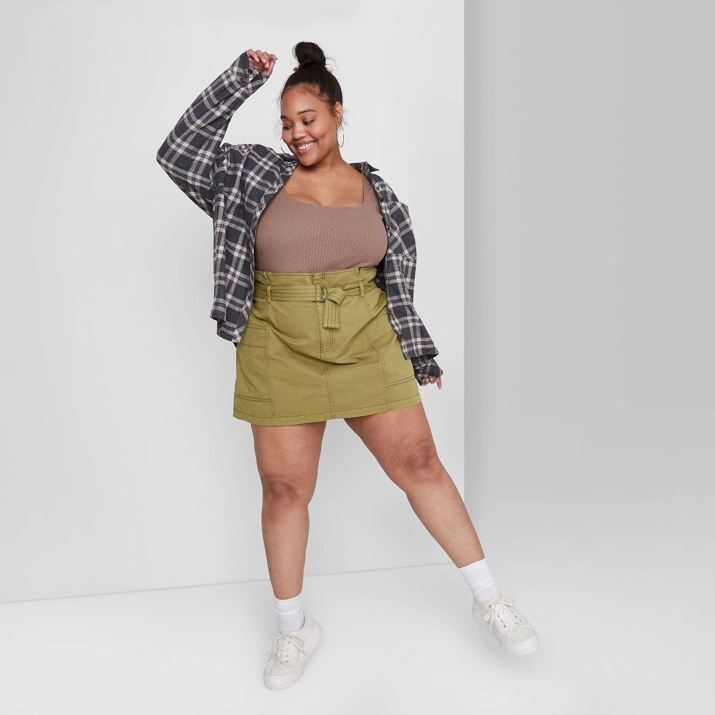 Model wearing olive green skirt