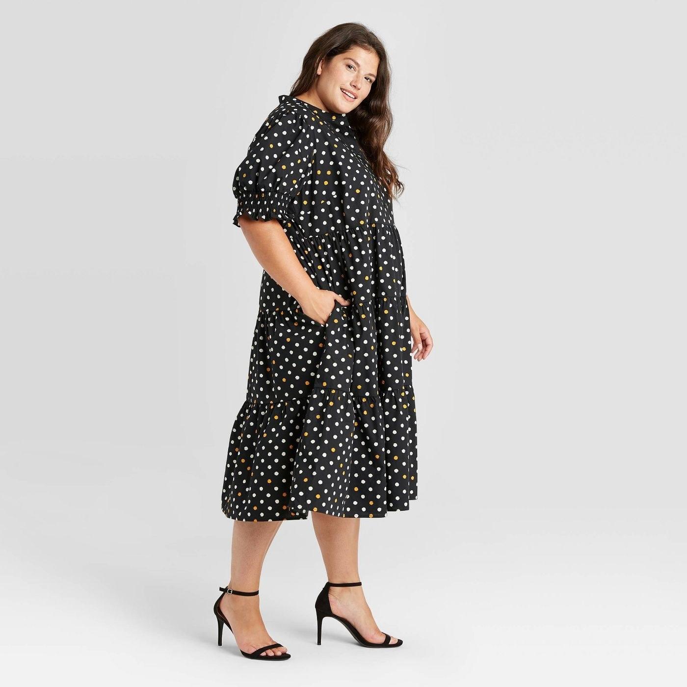 Model wearing polka dotted dress