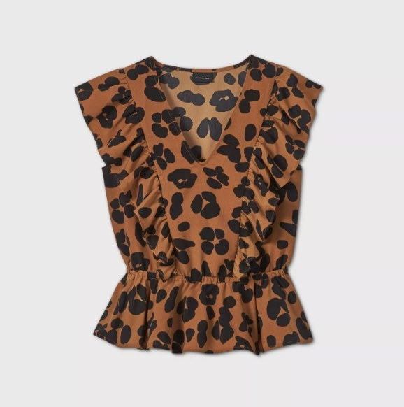 The cheetah print sleeveless blouse