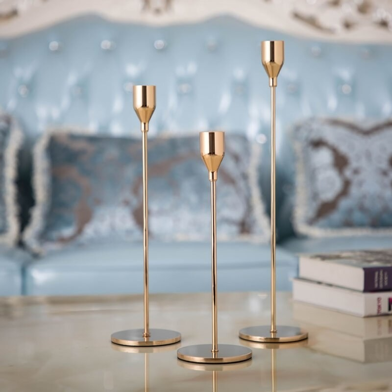 The gold candlestick holders