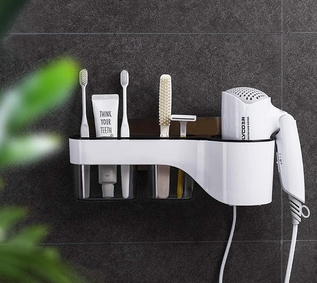 The organizer mounted on bathroom tile and stuffed with personal care items