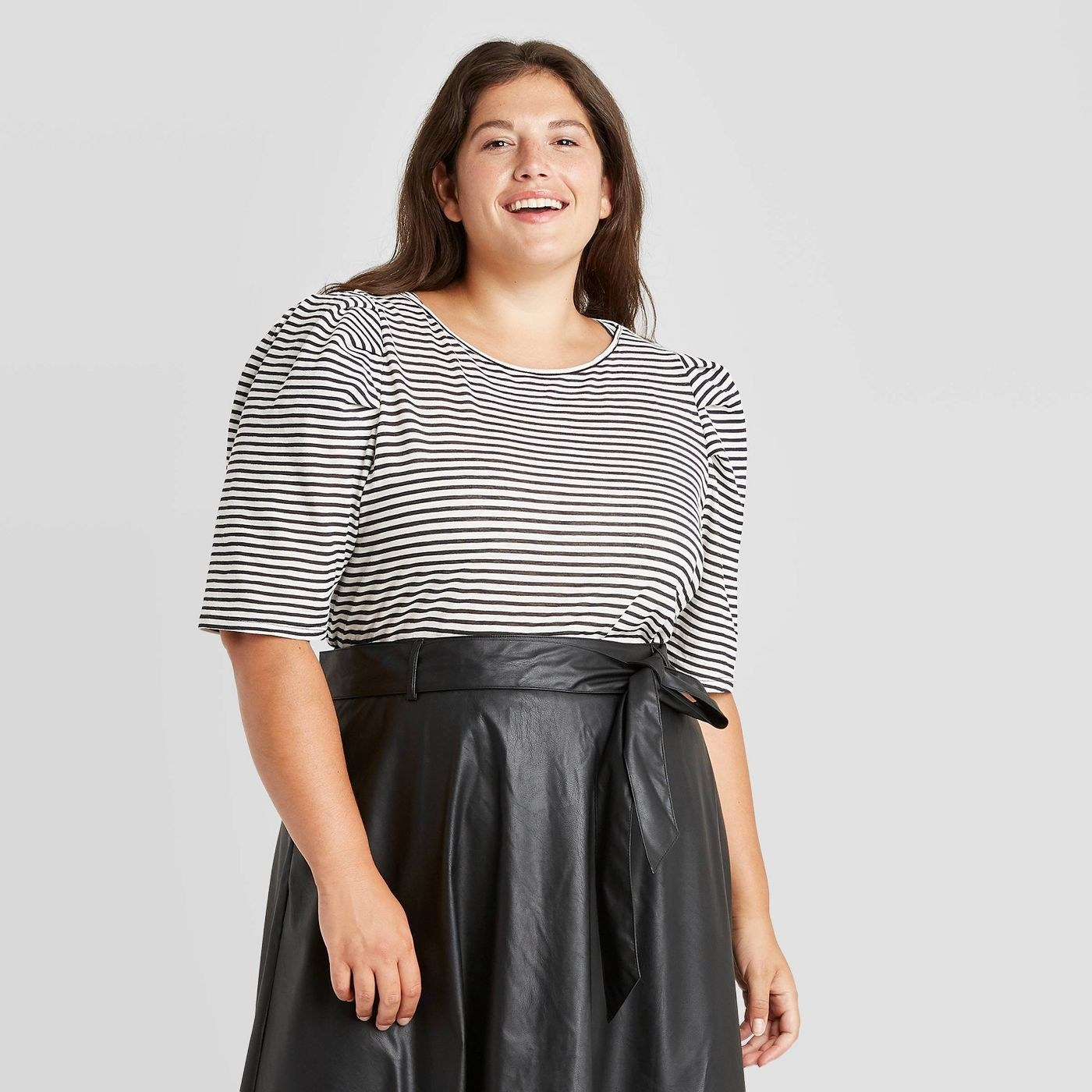 Model wearing black and white striped shirt