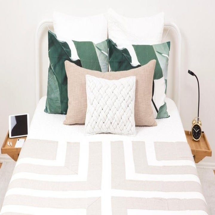 photo of two bedside tables attached to each side of the bed frame and holding different things