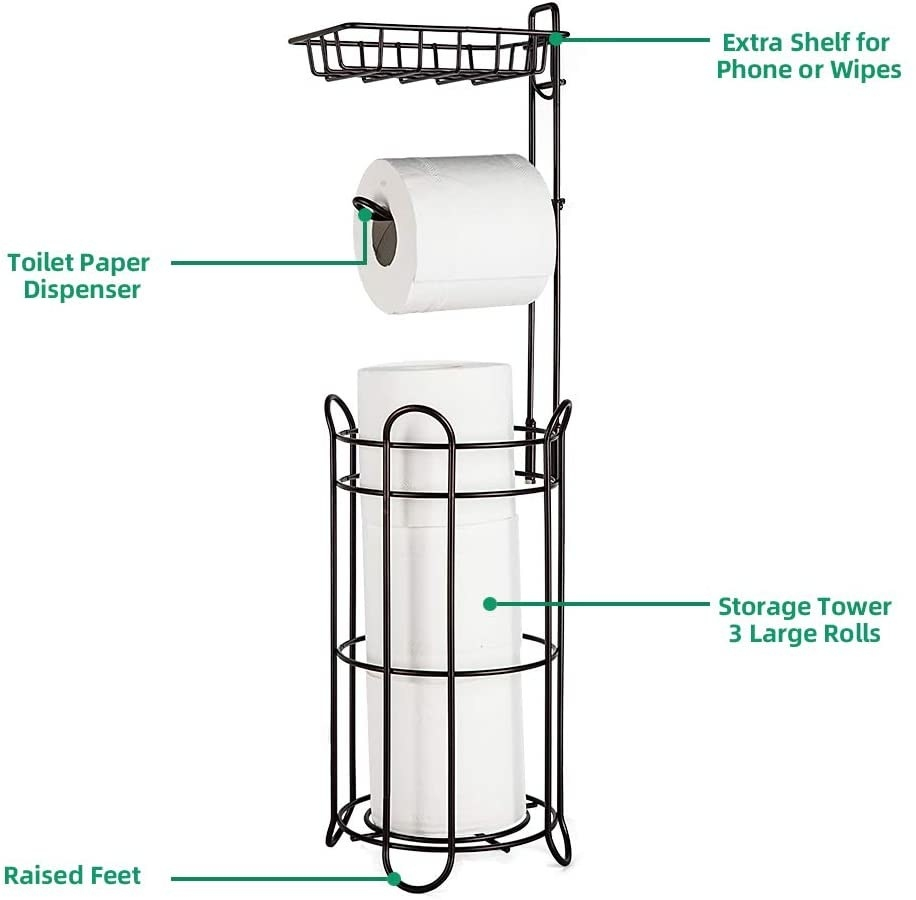 A black steel wired toilet paper tower with raised feet that holds three large rolls in the cylindrical basket, one roll on the dispenser, then has an extra basket shelf on top