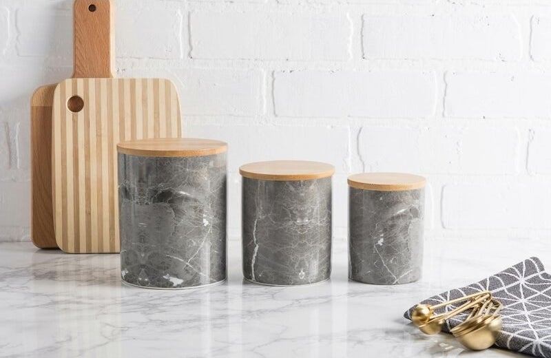 The three black and white canisters