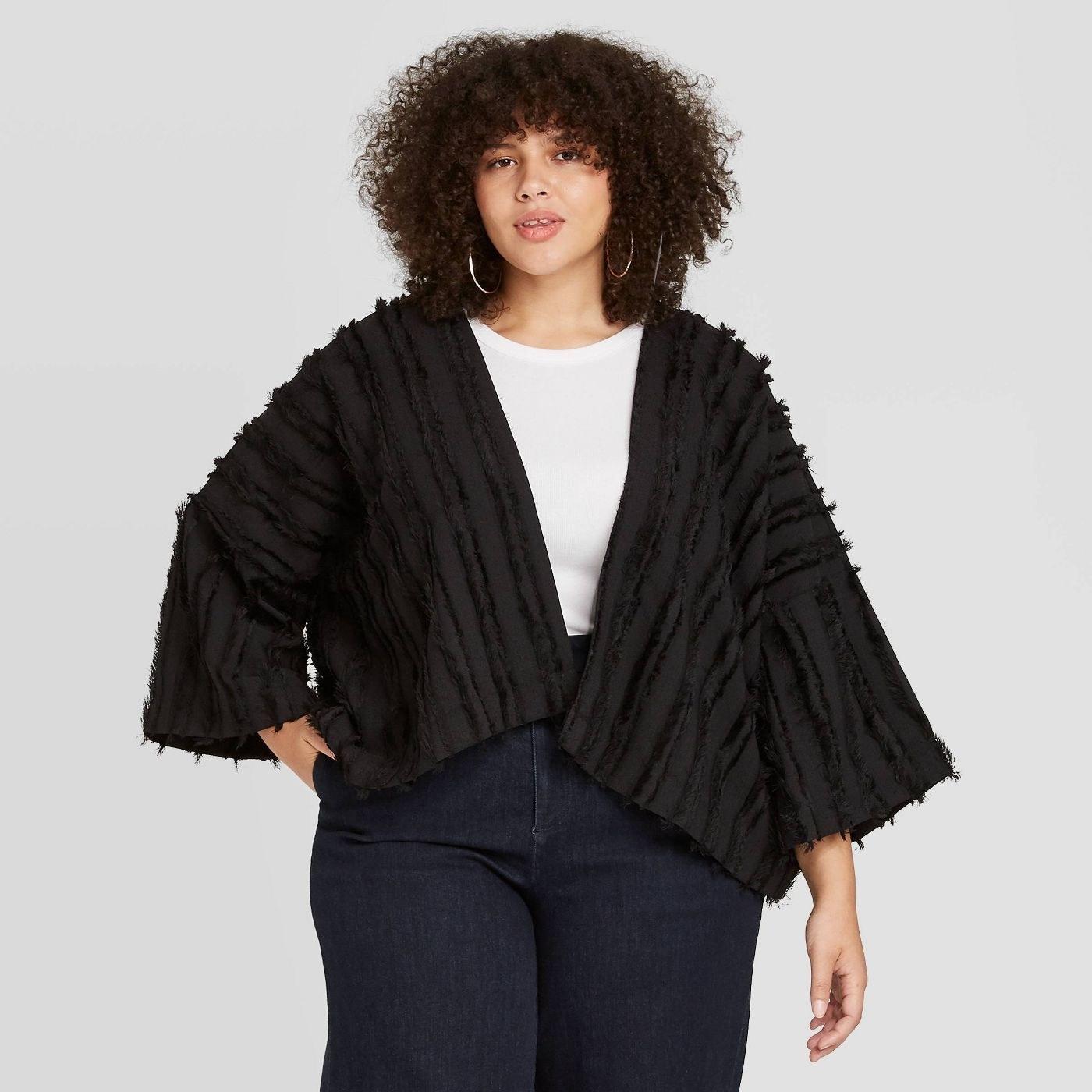 Model wearing black overcoat