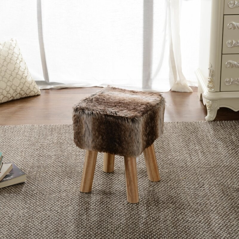The brown fur ottoman stool