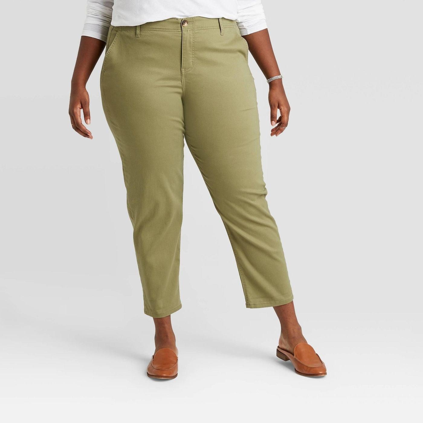 Model wearing olive green pants
