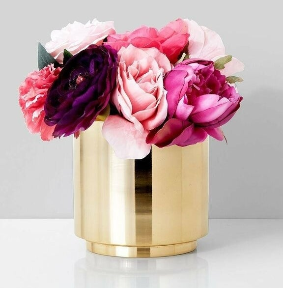 The gold vase with pink flowers