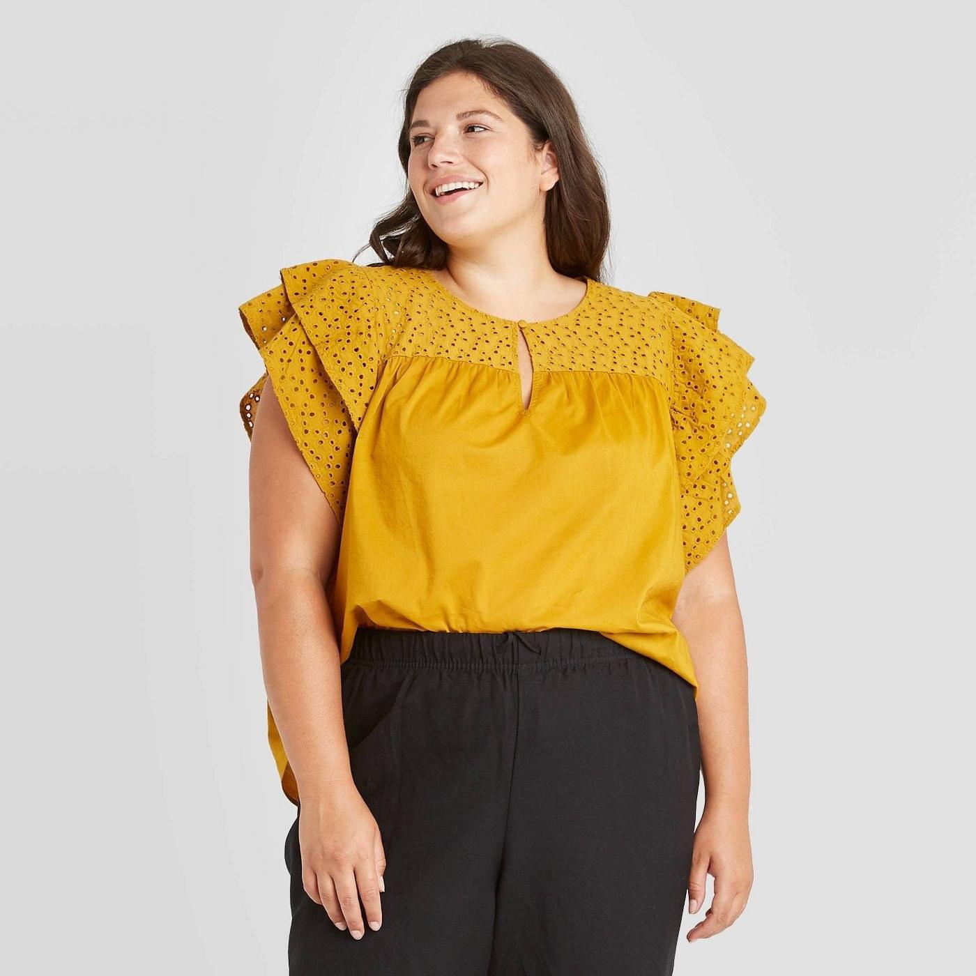 Model wearing yellow top