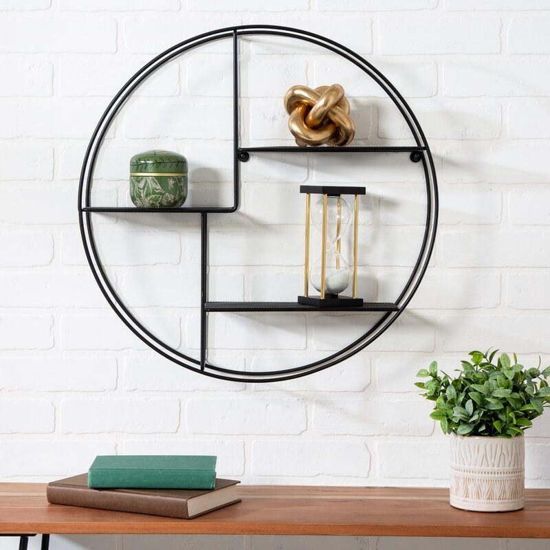 The black circular shelf hanging
