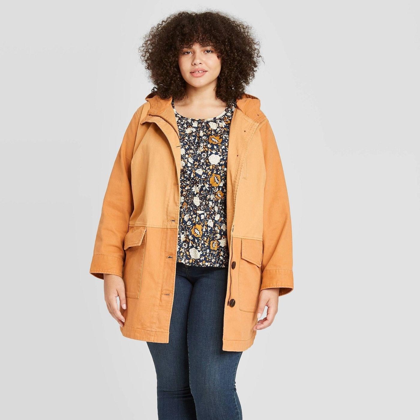 Model wearing orange coat
