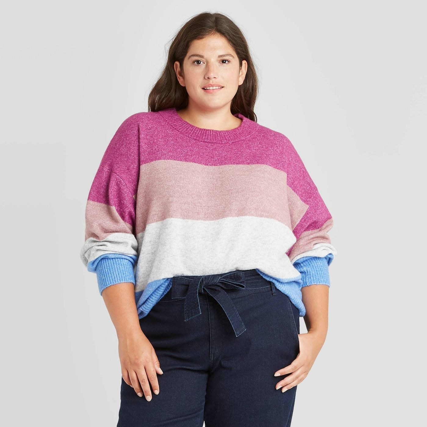 Model wearing striped sweater