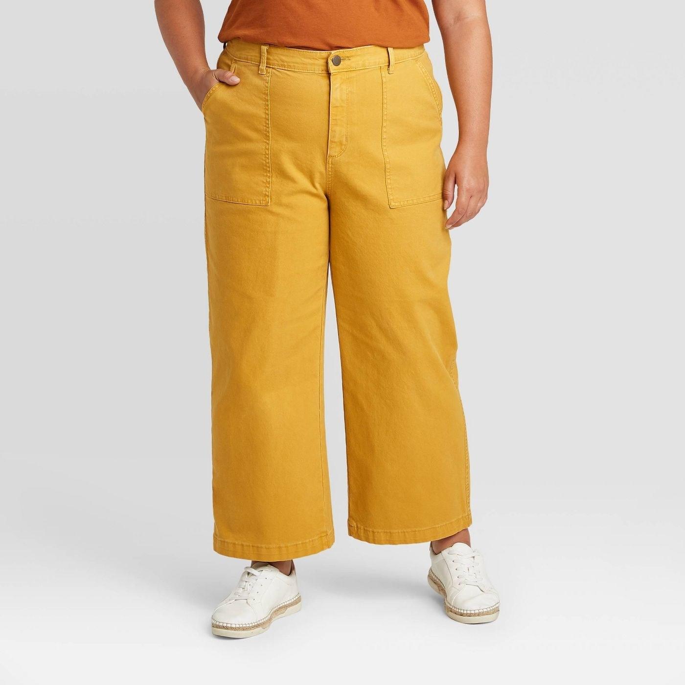 Model wearing yellow wide leg pants