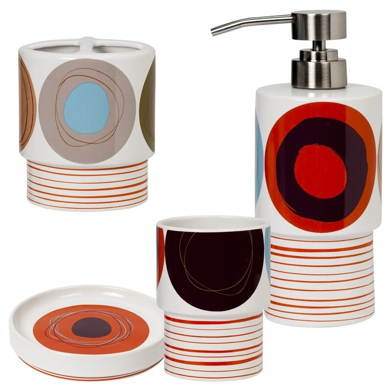 The white, orange, brown and red bathroom accessory set