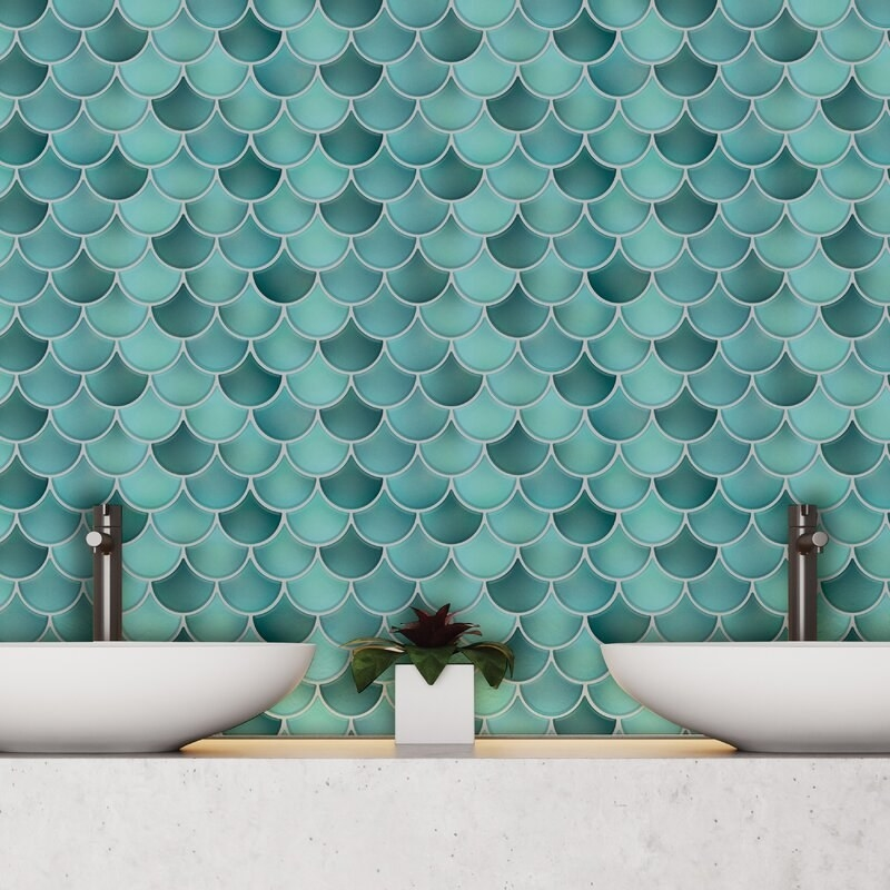 The blue mosaic tile on bathroom wall