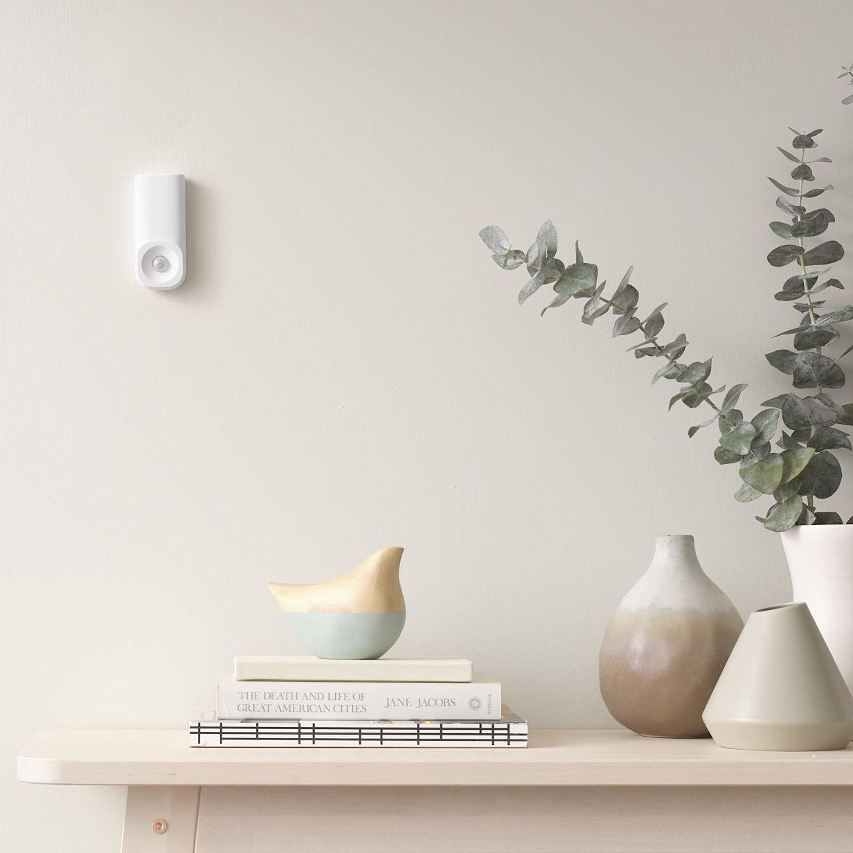 Motion sensor attached to a wall.