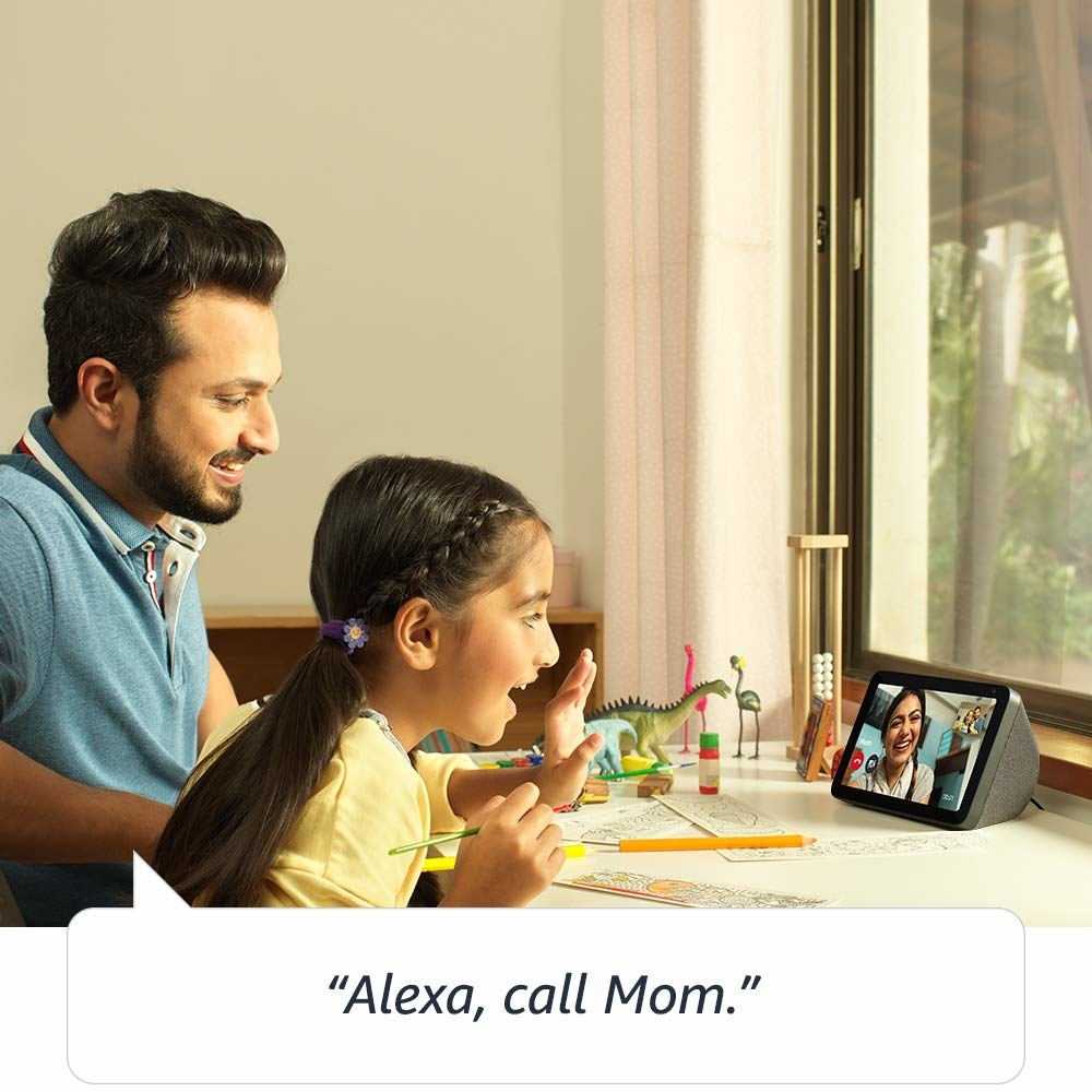 A father and daughter on a call using the device.