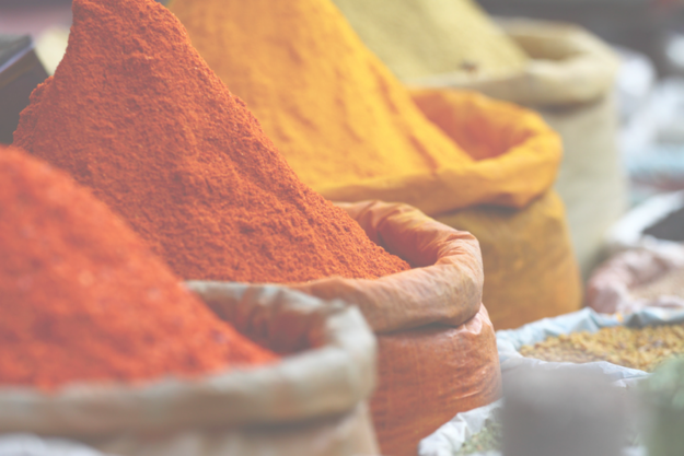 some indian spices with the overlaid text that says check off all the dishes you've had