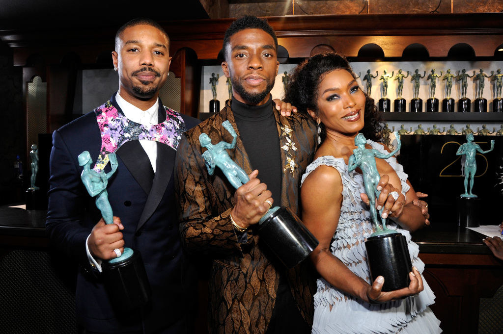 Michael B. Jordan, Chadwick Boseman, and Angela Bassett holding trophies