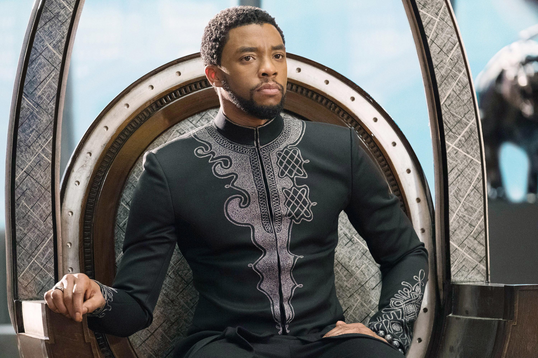 Chadwick Boseman as T'Challa sitting on a throne