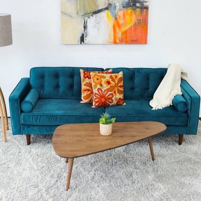 The velvet teal sofa
