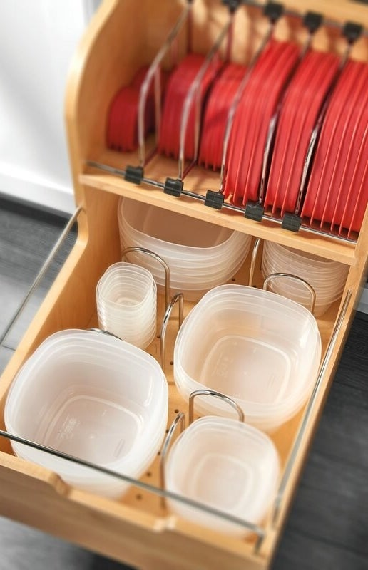 A wooden pull-out drawer holding food containers