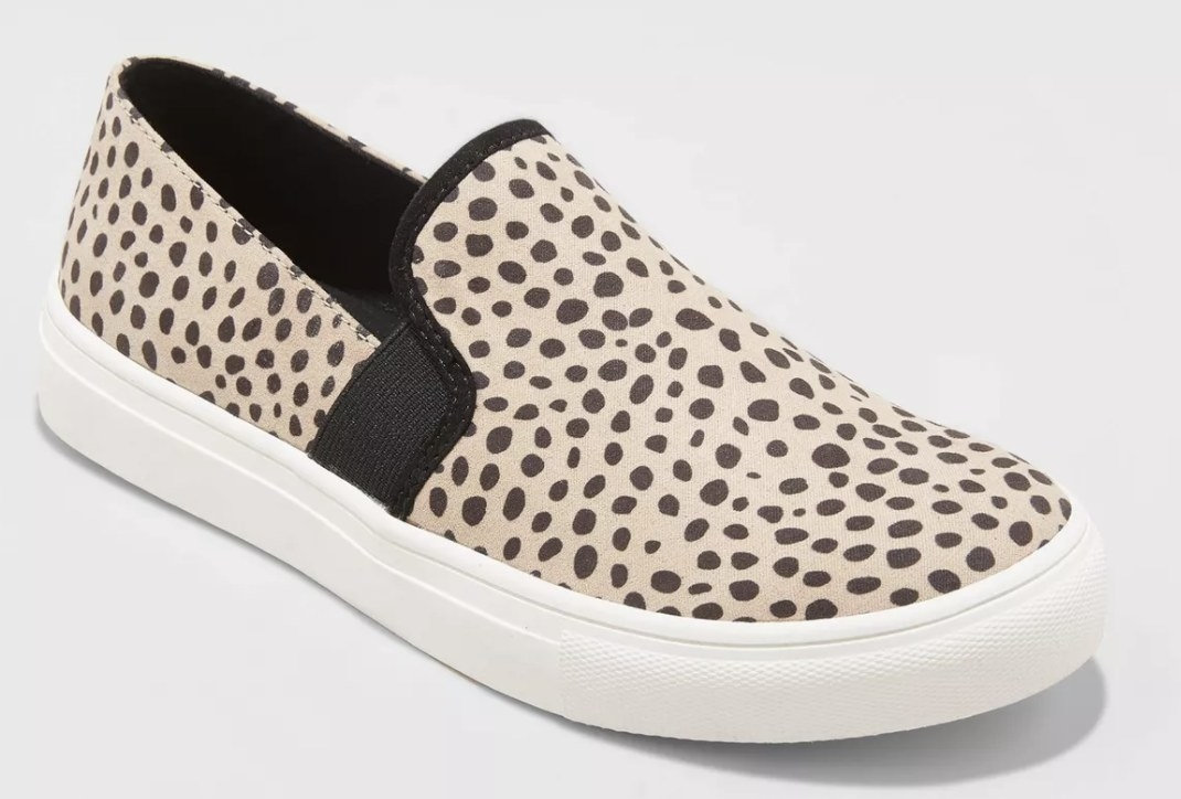 The cream and black animal print sneakers