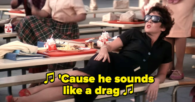 """Rizzo lying down on the bench during """"Summer Nights"""" wearing sunglasses, singing with attitude: """"'Cause he sounds like a drag"""""""