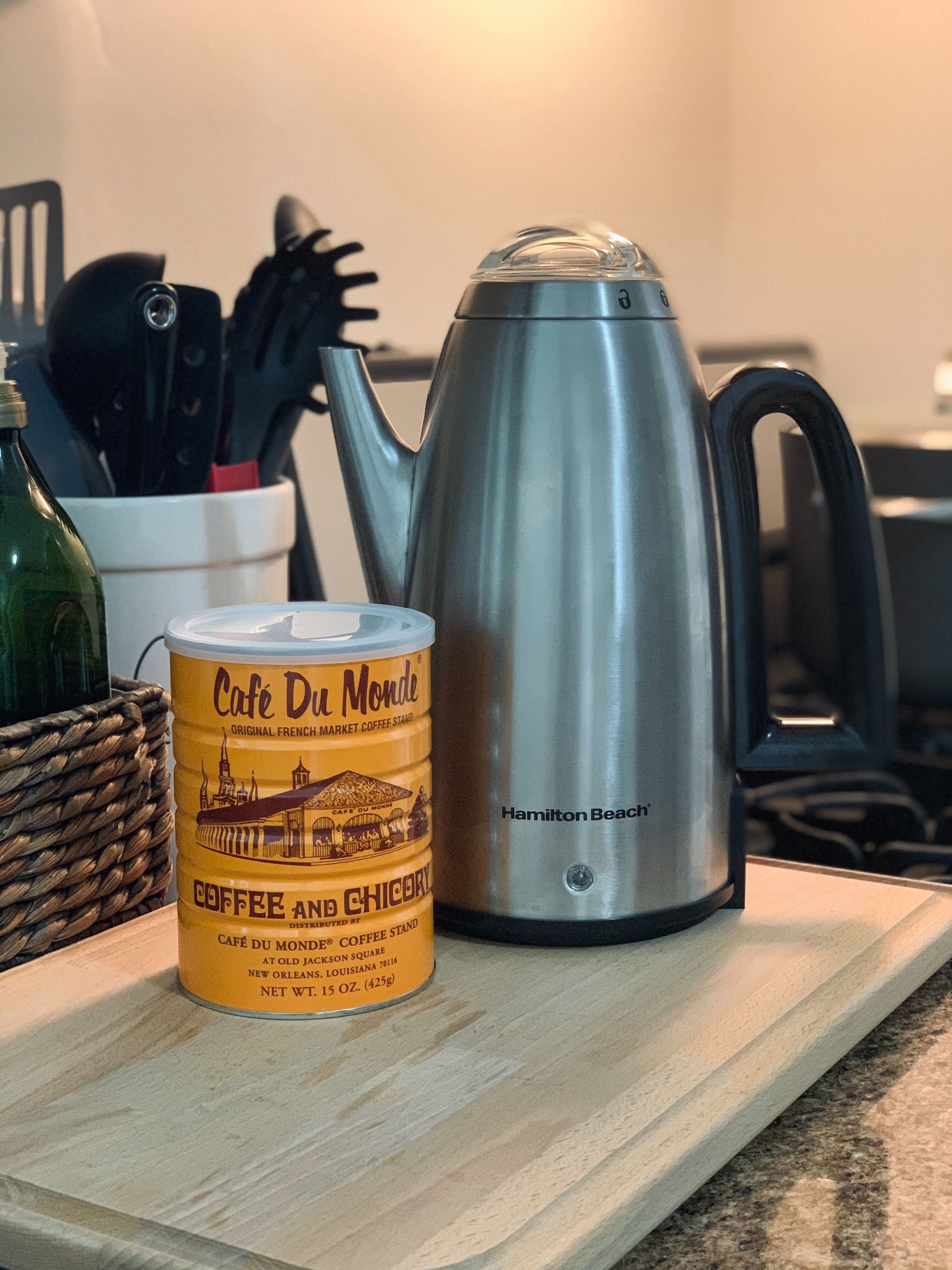 Canister of Cafe Du Monde coffee and a Hamilton Beach coffee percolator
