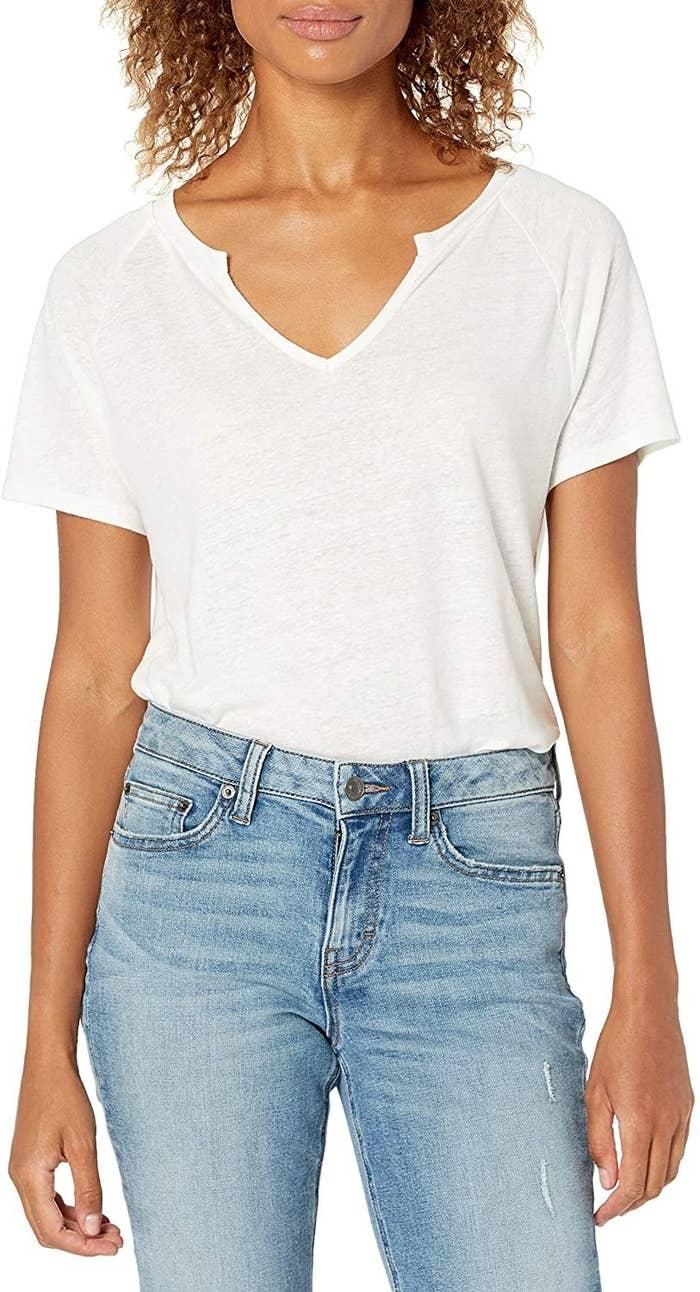 model wearing white crewneck top