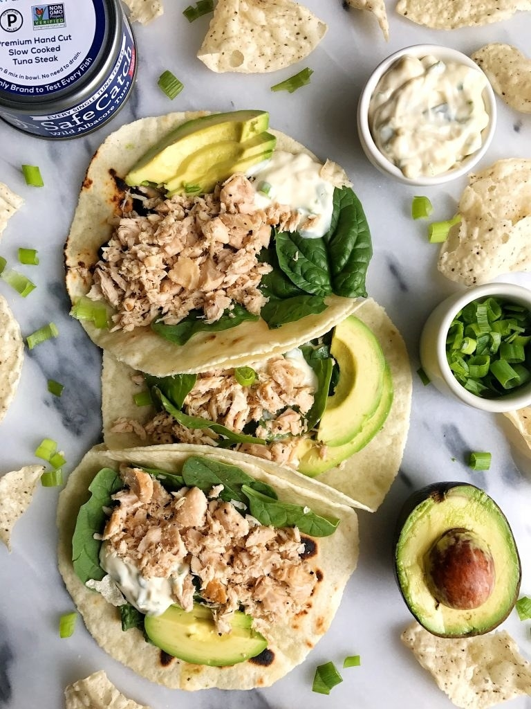 Three tortillas filled with spinach, tuna fish, and avocado.