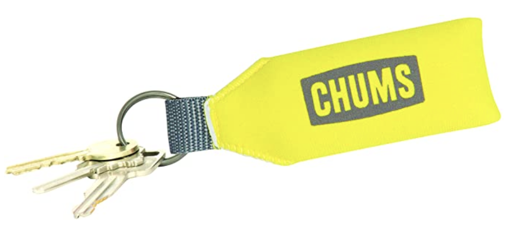 """The bright yellow keychain with the word """"chums"""" on it and three keys attached"""