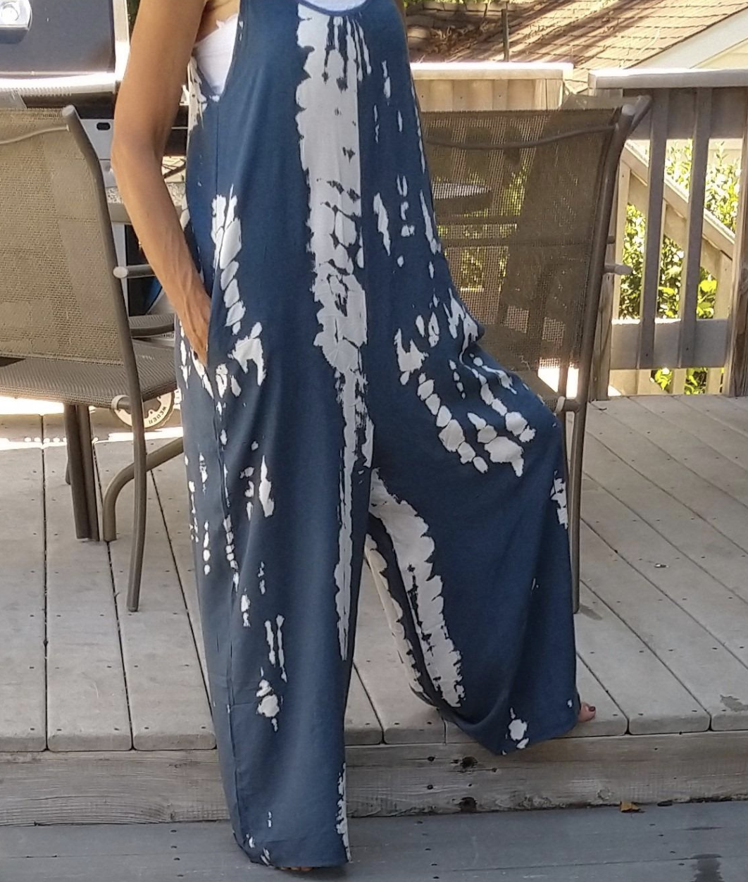reviewer wearing white and blue tie dye jumpsuit