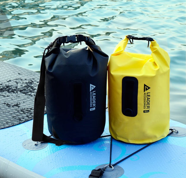 A black and yellow vinyl bag sitting on a kayak