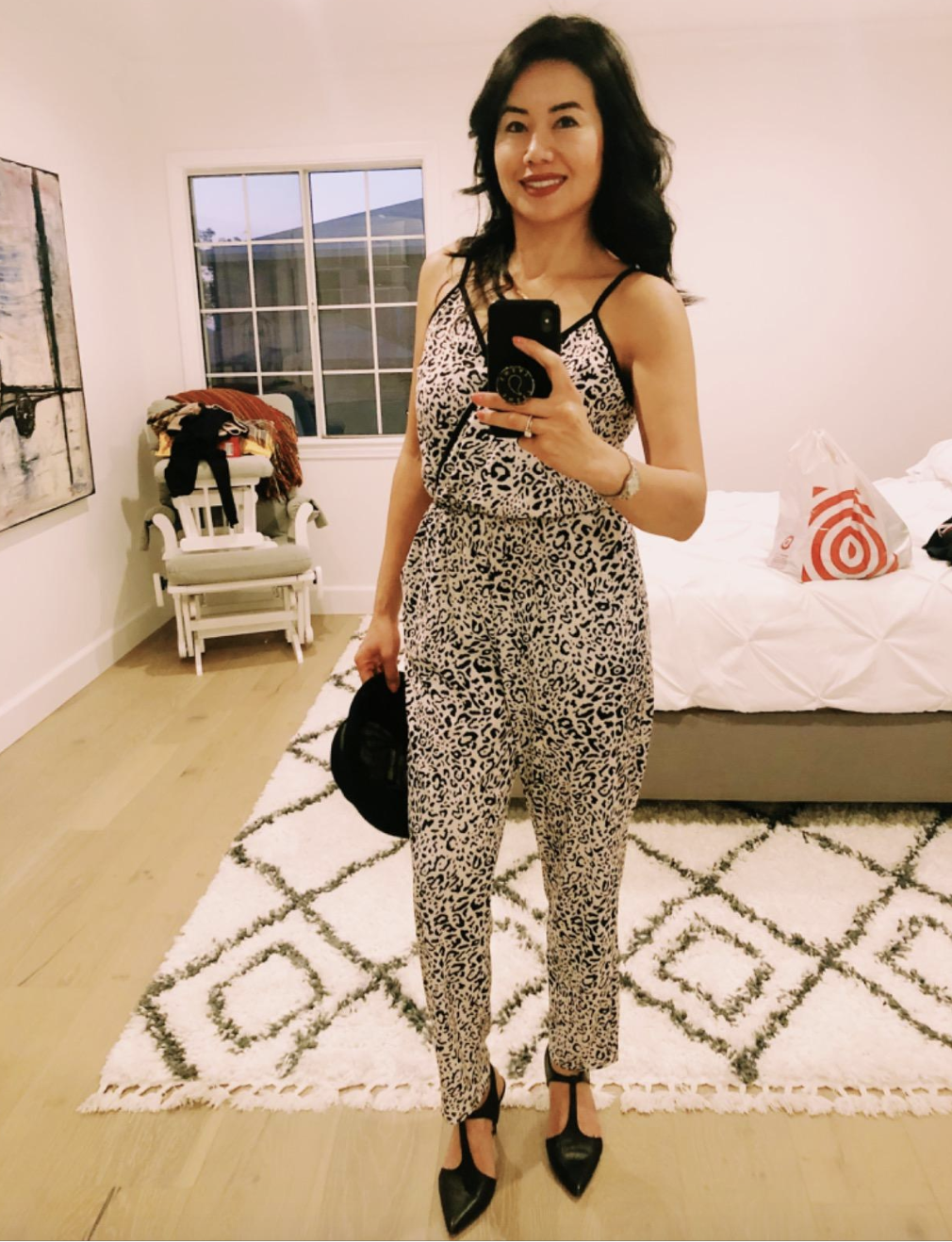 reviewer wearing the leopard V-neck tank jumpsuit