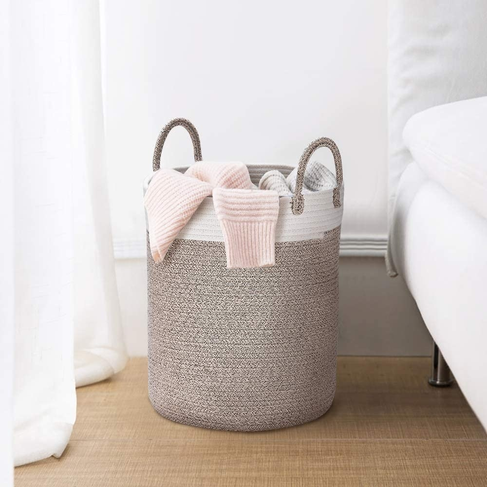 a woven rope-like basket with handles