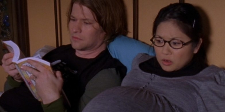 heavily pregnant Lane lying down with her husband Zach