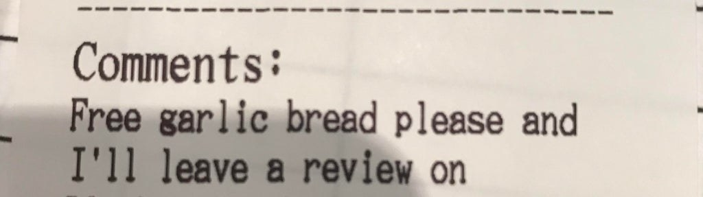 Someone asks a restaurant for free garlic bread in exchange for a review