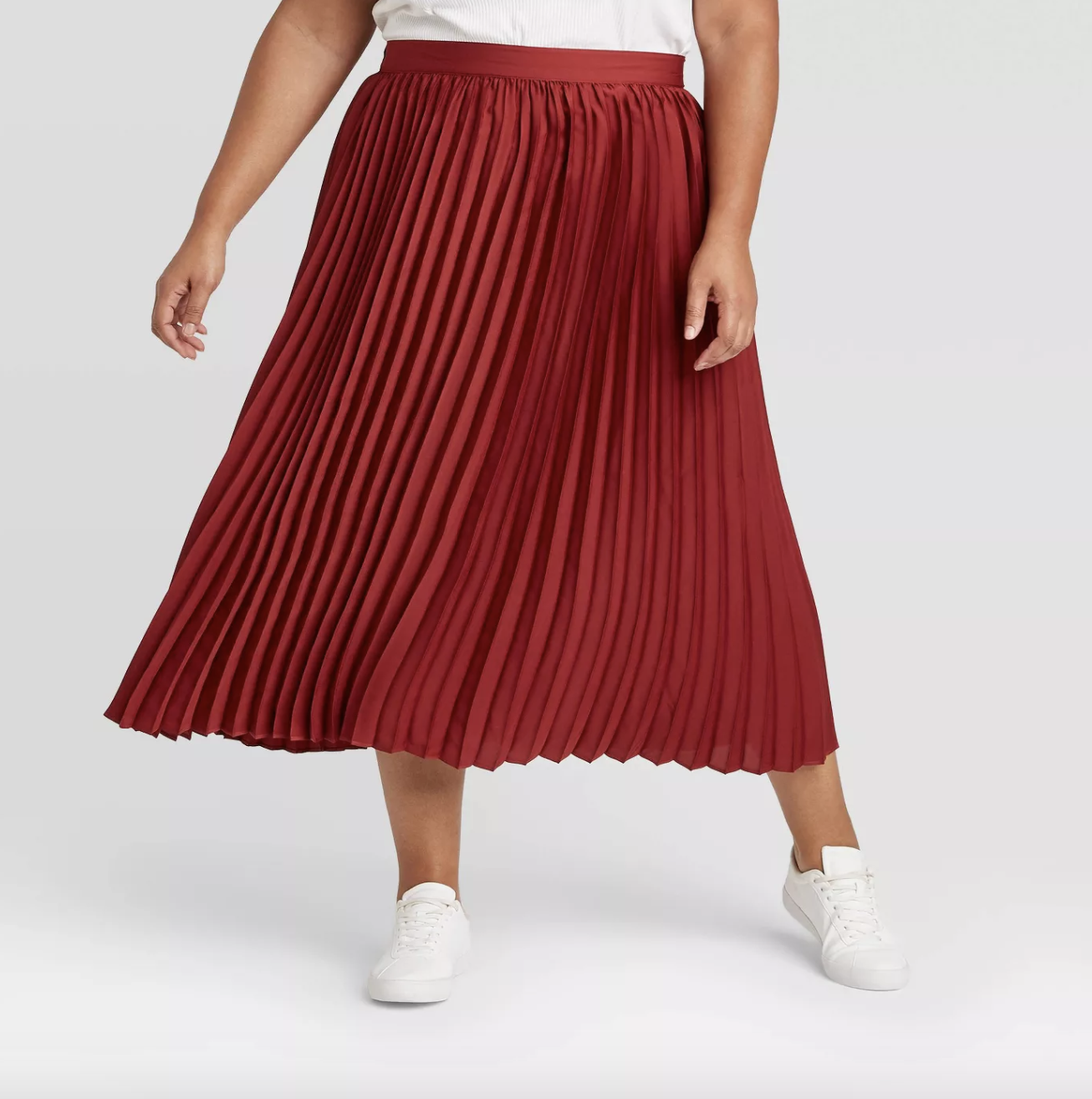 model wearing red pleated midi skirt