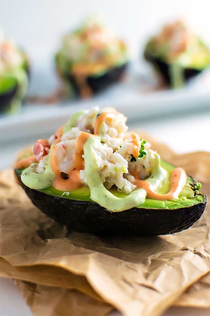 A half of an avocado stuffed with shrimp and crab meat in a spicy mayo sauce.