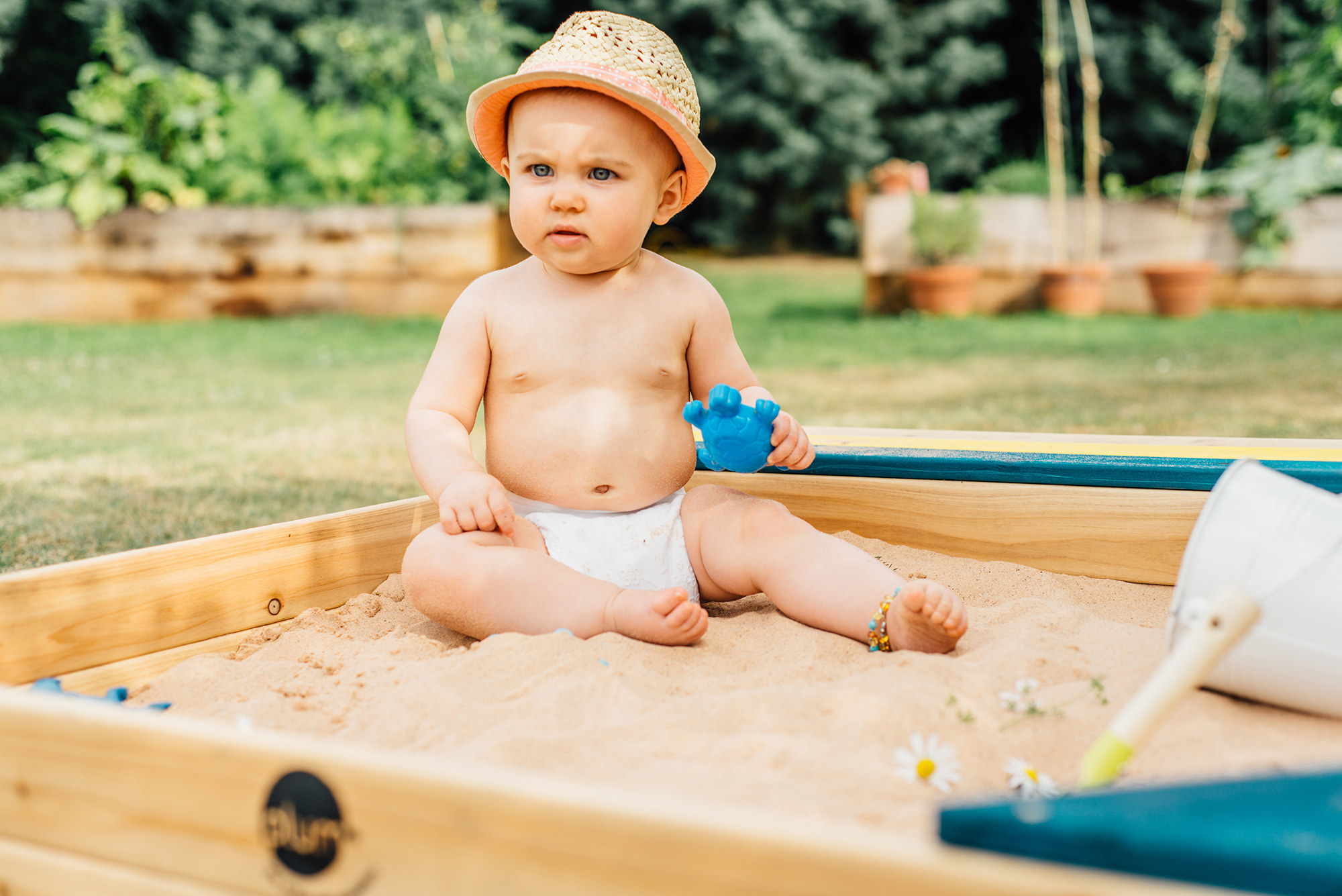 A baby in the sandbox